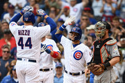 Javier Baez #9 of the Chicago Cubs congratulates Anthony Rizzo #44 after a three run home run against the Miami Marlins during the third inning of a game at Wrigley Field on May 9, 2018 in Chicago, Illinois.