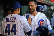 Kris Bryant #17 of the Chicago Cubs is congratulated by Anthony Rizzo #44 after hitting a two run home run in the 1st inning against the Miami Marlins at Wrigley Field on May 7, 2018 in Chicago, Illinois.