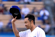 Olympic swimmer Kosuke Kitajima of Japan reacts after throwing out a ceremonial first pitch before the game against the Miami Marlins at Dodger Stadium on May 18, 2017 in Los Angeles, California.