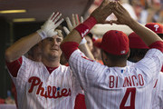 Tommy Joseph #19 of the Philadelphia Phillies hits a solo home run in the bottom of the fourth inning and high fives Andres Blanco #4 in the dugout against the Miami Marlins at Citizens Bank Park on July 19, 2016 in Philadelphia, Pennsylvania. The Marlins defeated the Phillies 2-1 in 10 innings.