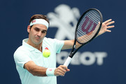 Roger Federer of Switzerland returns a shot to John Isner during the men's final of the Miami Open Presented by Itau at Hard Rock Stadium March 31, 2019 in Miami Gardens, Florida.