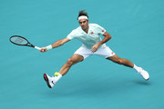 Roger Federer of Switzerland in action against John Isner of USA in the final during day fourteen of the Miami Open tennis on March 31, 2019 in Miami Gardens, Florida.