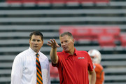 Head coaches Al Golden (L) of the Miami Hurricanes and Randy Edsall (R) of the Maryland Terrapins talk before the start of their game at Byrd Stadium on September 5, 2011 in College Park, Maryland.