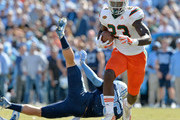 Christopher Herndon IV #23 of the Miami Hurricanes breaks away from Cole Holcomb #36 of the North Carolina Tar Heels for a touchdown during the second quarter of their game at Kenan Stadium on October 28, 2017 in Chapel Hill, North Carolina.