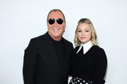 Michael Kors and Olivia Holt pose backstage during the Michael Kors FW20 Runway Show on February 12, 2020 in New York City.
