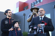 Michael Long supported by his son Jake Long and gradnson speaks to the media infront of a statue of himself at The Hangar at the Essendon Bombers Football Club on July 17, 2018 in Melbourne, Australia. Former player Michael Long is being recognised for this contribution to honouring Australia's First Nations Peoples.