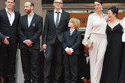 """(L to R) Actors Viktor Tremmel, Michael Fuith, director Markus Schleinzer, actors David Rauchenberger, Ursula Strauss, and Gisella Salcher attend the """"Michael"""" premiere at the Palais des Festivals during the 64th Cannes Film Festival on May 14, 2011 in Cannes, France."""