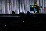 """Michelle Obama on stage as part of her """"Becoming: An Intimate Conversation With Michelle Obama"""" tour at The O2 Arena on April 14, 2019 in London, England."""