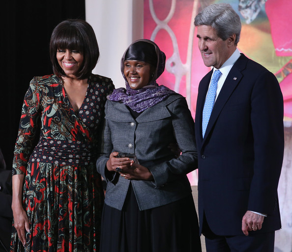 """Michelle Obama Elman Peace and Human Rights Centre Executive Director Fartuun Adan (C) of Somalia poses for photographs with U.S. Secretary of State John Kerry (R) and U.S. first lady Michelle Obama after receiving the International Women of Courage award at the State Department March 8, 2013 in Washington, DC. In celebration of the 102nd International Women's Day, the State Department honored nine women from around the world with the International Women of Courage Award, including the 23-year-old Indian woman known only as """"Nirbhaya,"""" who died from injuries she received after being gang raped by six men last December in Delhi."""