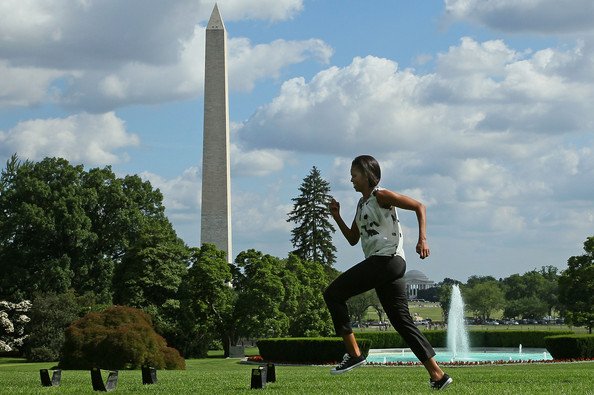 First lady Michelle Obama runs an obstacle course with Washington area students on the South Lawn of the White House on May 25, 2010 in Washington, DC. The first lady kicked of the first in a South Lawn series of summer activities for kids.