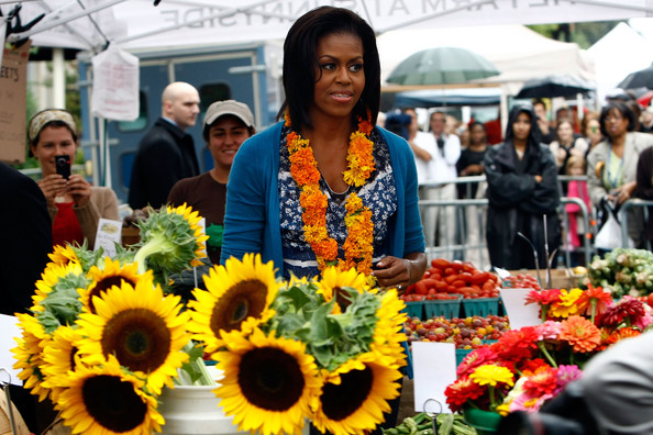 Michelle Obama Visits New Farmers Market In Washington DC [flower,public space,yellow,floristry,sunflower,plant,market,event,floral design,gerbera,michelle obama,city officials,farmers market,blocks,produce,new farmers market in washington dc,u.s.,shops,vendors,opening]