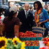 Michelle Obama Photos - U.S. first lady Michelle Obama shops for fresh produce with Assistant White House Chef Sam Kass at the opening of a new farmer's market two blocks from the White House September 17, 2009 in Washington, DC. The new market will be open every Thursday for the next seven weeks as city officials close down an entire block to facilitate the farmer's market. - Michelle Obama Visits New Farmers Market In Washington DC