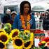 Michelle Obama Photos - U.S. first lady Michelle Obama greets vendors as she shops for fresh produce at the opening of a new farmer's market two blocks from the White House September 17, 2009 in Washington, DC. The new market will be open every Thursday for the next seven weeks as city officials close down an entire block to facilitate the farmer's market. - Michelle Obama Visits New Farmers Market In Washington DC