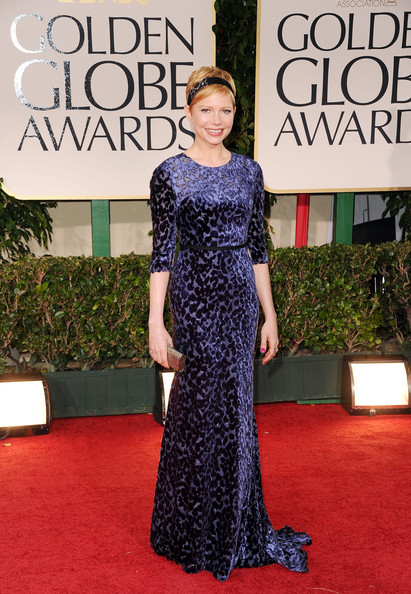 69th Annual Golden Globe Awards - Arrivals [flooring,carpet,dress,red carpet,gown,beauty,lady,fashion,fashion model,shoulder,arrivals,michelle williams,beverly hills,california,beverly hilton hotel,golden globe awards,69th annual golden globe awards]