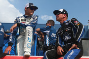 Kyle Larson, driver of the #42 DC Solar Chevrolet, and Clint Bowyer, driver of the #14 Haas 30 Years of the VF1 Ford, talk on the grid during qualifying for the Monster Energy NASCAR Cup Series Consmers Energy 400 at Michigan International Speedway on August 10, 2018 in Brooklyn, Michigan.