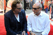 Actor Mickey Rourke and producer Gianni Nunnari attend Micky Rourke's Hand and Footprint Ceremony held at Grauman's Chinese Theatre on October 31, 2011 in Hollywood, California.