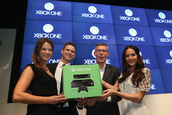 Actress Jessica Schwarz (L), Microsoft Germany  Consumer Channel Group General Manager Oliver Kaltner, Microsoft Germany head Christian Illek and Johanna Klum attend the launch party of the Microsoft Xbox One at the Microsoft Center on November 21, 2013 in Berlin, Germany. Microsoft is launching the new console to compete against the new Sony Playstation 4 ahead of Christmas.