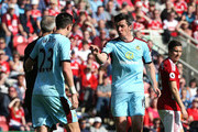 Joey Barton of Burnley (R) argues with referee Martin Atkinson during the Premier League match between Middlesbrough and Burnley at Riverside Stadium on April 8, 2017 in Middlesbrough, England.