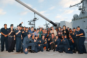 "The cast of ""Midway"" stands with a group of sailors aboard the USS Hasley on October 20, 2019 in Honolulu, Hawaii."