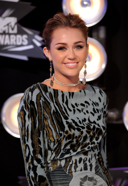 Miley Cyrus Singer Miley Cyrus arrives at the 2011 MTV Video Music Awards at Nokia Theatre L.A. LIVE on August 28, 2011 in Los Angeles, California.