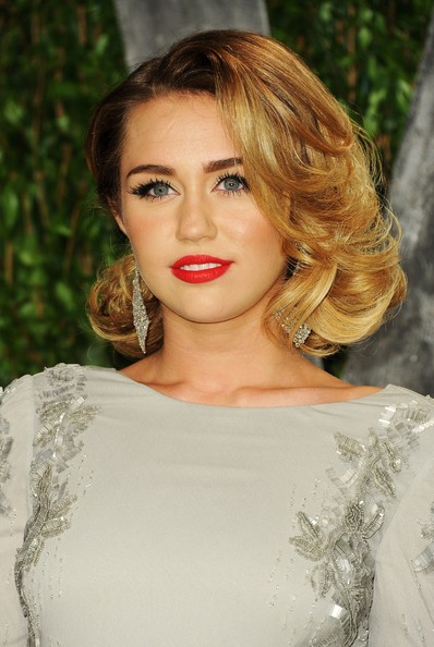 Miley Cyrus Singer/actress Miley Cyrus arrives at the 2012 Vanity Fair Oscar Party hosted by Graydon Carter at Sunset Tower on February 26, 2012 in West Hollywood, California.