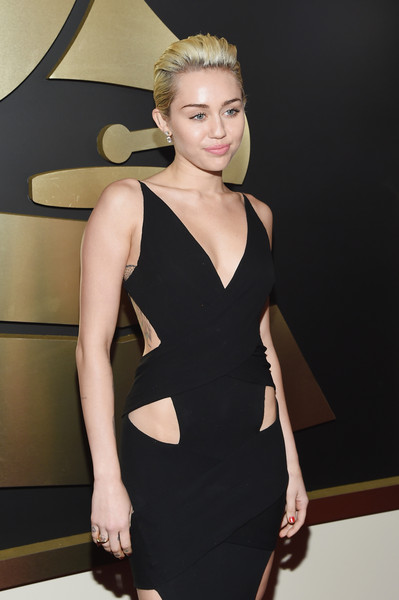 The 57th Annual GRAMMY Awards - Red Carpet [red carpet,dress,clothing,cocktail dress,shoulder,fashion model,little black dress,fashion,beauty,hairstyle,blond,miley cyrus,california,los angeles,staples center,57th annual grammy awards,the 57th annual grammy awards]