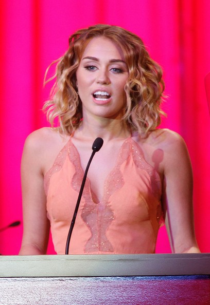 Miley Cyrus Actress/singer Miley Cyrus onstage during Muhammad Ali's Celebrity Fight Night XIII held at JW Marriott Desert Ridge Resort & Spa on March 24, 2012 in Phoenix, Arizona.