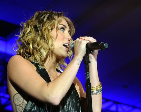 Miley Cyrus Singer/actress Miley Cyrus performs onstage during Muhammad Ali's Celebrity Fight Night XIII held at JW Marriott Desert Ridge Resort & Spa on March 24, 2012 in Phoenix, Arizona.