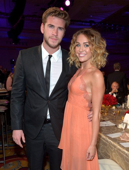 Miley Cyrus Actor Liam Hemsworth (L) and singer/actress Miley Cyrus attend Muhammad Ali's Celebrity Fight Night XIII held at JW Marriott Desert Ridge Resort & Spa on March 24, 2012 in Phoenix, Arizona.
