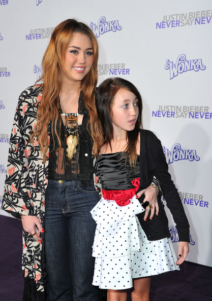 """Miley Cyrus Actress/singer Miley Cyrus and actress Noah Cyrus arrive at the premiere of Paramount Pictures' """"Justin Bieber: Never Say Never"""" held at Nokia Theater L.A. Live on February 8, 2011 in Los Angeles, California."""