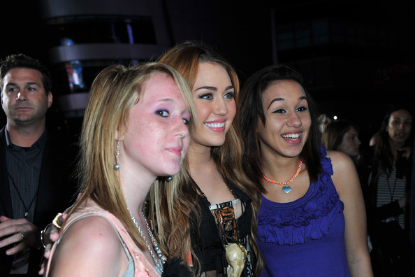 """Miley Cyrus Singer/actress Miley Cyrus poses with fans at the premiere of Paramount Pictures' """"Justin Bieber: Never Say Never"""" held at Nokia Theater L.A. Live on February 8, 2011 in Los Angeles, California."""