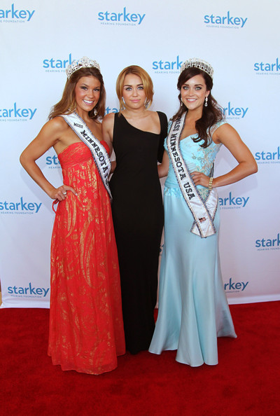"Miley Cyrus (L-R) Miss Minnesota Teen Hannah Corbett, Miley Cyrus and Miss Minnesota USA Brittney Thelemann attend the Starkey Hearing Foundation's ""So The World May Hear Awards Gala"" 2011 at River Centre on July 24, 2011 in St. Paul, Minnesota."