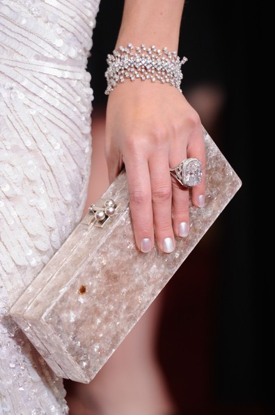 Milla Jovovich Actress Milla Jovovich (jewelry and handbag detail) arrives at the 84th Annual Academy Awards held at the Hollywood & Highland Center on February 26, 2012 in Hollywood, California.