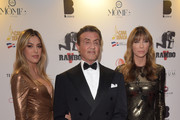 (L-R) Sistine Rose Stallone, Sylvester Stallone, and Jennifer Flavin attend Millennium Media Dinner And Cocktail Reception In Honor Of   Sylvester Stallone on May 24, 2019 in Cannes, France.