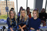 Christie Ferrari,  Morgan Stewart and Katherine McNamara attend the Milly by Michelle Smith front row during New York Fashion Week: The Shows at Gallery II at Spring Studios on September 7, 2018 in New York City.