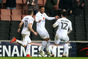 Nicky Maynard of MK Dons (C) celebrates scoring his sides first goal with team mates during the Sky Bet League One match between Milton Keynes Dons and Oldham Athletic at StadiumMK on February 7, 2017 in Milton Keynes, England.