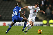Ousmane Fane of Oldham Athletic closes down Joe Walsh of MK Dons during the Sky Bet League One match between Milton Keynes Dons and Oldham Athletic at StadiumMK on February 7, 2017 in Milton Keynes, England.