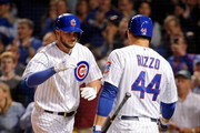 Kris Bryant #17 of the Chicago Cubs is congratulated by Anthony Rizzo #44 after hitting a two-run home run against the Milwaukee Brewers during the third inning at Wrigley Field on September 22, 2015 in Chicago, Illinois. The blast was Bryant's 25th of the season, breaking Hall of Famer Billy Williams's rookie home run record set in 1961.