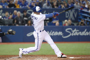 Troy Tulowitzki #2 of the Toronto Blue Jays hits an RBI double in the first inning during MLB game action against the Milwaukee Brewers at Rogers Centre on April 11, 2017 in Toronto, Canada.