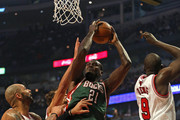 Samuel Dalembert #21 of the Milwaukee Bucks shoots between Carlos Boozer #5 and Loul Deng #9 of the Chicago Bulls at the United Center on November 26, 2012 in Chicago, Illinois. The Bucks defeated the Bulls 93-92. NOTE TO USER: User expressly acknowledges and agrees that, by downloading and or using this photograph, User is consenting to the terms and conditions of the Getty Images License Agreement.