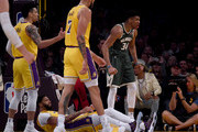 Giannis Antetokounmpo #34 of the Milwaukee Bucks celebrates his basket and a Anthony Davis #3 of the Los Angeles Lakers blocking foul during the first half at Staples Center on March 06, 2020 in Los Angeles, California.  NOTE TO USER: User expressly acknowledges and agrees that, by downloading and or using this photograph, User is consenting to the terms and conditions of the Getty Images License Agreement.