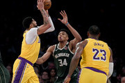 Anthony Davis #3 of the Los Angeles Lakers attempts a shot on Giannis Antetokounmpo #34 of the Milwaukee Bucks with LeBron James #23 during the third quarter at Staples Center on March 06, 2020 in Los Angeles, California.  NOTE TO USER: User expressly acknowledges and agrees that, by downloading and or using this photograph, User is consenting to the terms and conditions of the Getty Images License Agreement.