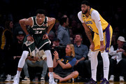 Giannis Antetokounmpo #34 of the Milwaukee Bucks and Anthony Davis #3 of the Los Angeles Lakers wait during the third quarter at Staples Center on March 06, 2020 in Los Angeles, California.  NOTE TO USER: User expressly acknowledges and agrees that, by downloading and or using this photograph, User is consenting to the terms and conditions of the Getty Images License Agreement.