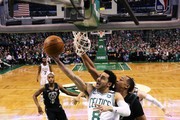 Shane Larkin #8 of the Boston Celtics takes a shot against John Henson #31 of the Milwaukee Bucks during Game Two in Round One of the 2018 NBA Playoffs at TD Garden on April 17, 2018 in Boston, Massachusetts. The Celtics defeat the Bucks 120-106.