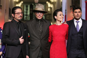"""(L-R) Hiroyuki Sanada, Johnny Depp, Minami and director Andrew Levitas pose at the """"Minamata"""" premiere during the 70th Berlinale International Film Festival Berlin at Friedrichstadt-Palast on February 21, 2020 in Berlin, Germany."""