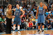 Head coach Cheryl Reeve, Lindsay Whalen #13 and Maya Moore #23 of the Minnesota Lynx converse in the final minutes of their 73-67 win over the Atlanta Dream in Game Three of the 2011 WNBA Finals at Philips Arena on October 7, 2011 in Atlanta, Georgia.  NOTE TO USER: User expressly acknowledges and agrees that, by downloading and or using this Photograph, user is consenting to the terms and conditions of the Getty Images License Agreement.