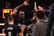 Kevin Garnett #21 of the Minnesota Timberwolves celebrates a 112-111 win over the Los Angeles Lakers with the bench at Staples Center on October 28, 2015 in Los Angeles, California.  NOTE TO USER: User expressly acknowledges and agrees that, by downloading and or using this Photograph, user is consenting to the terms and condition of the Getty Images License Agreement.
