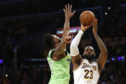 LeBron James #23 of the Los Angeles Lakers shoots the ball as Karl-Anthony Towns #32 of the Minnesota Timberwolves defends during the second half at Staples Center on December 08, 2019 in Los Angeles, California. NOTE TO USER: User expressly acknowledges and agrees that, by downloading and or using this photograph, User is consenting to the terms and conditions of the Getty Images License Agreement.