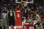 James Harden #13 of the Houston Rockets goes up for a dunk against Karl-Anthony Towns #32 of the Minnesota Timberwolves in the second half during Game One of the first round of the 2018 NBA Playoffs at Toyota Center on April 15, 2018 in Houston, Texas.  NOTE TO USER: User expressly acknowledges and agrees that, by downloading and or using this photograph, User is consenting to the terms and conditions of the Getty Images License Agreement.