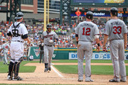 Ryan Doumit #9 of the Minnesota Twins is greeted at home plate by Chris Herrmann #12 and Justin Morneau #33 after hitting a three-run home run in the fifth inning of the game against the Detroit Tigers at Comerica Park on August 22, 2013 in Detroit, Michigan.